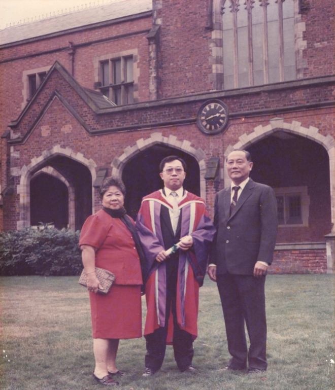 "The ""brand new"" Dr. Chow Yong Neng on December 17, 1990 with his late mother, Mdam Wan Sim Then and late father Mr. Chow Kong Yong by his sides, taken on the lawn behind the Lanyon Building, Queen's University of Belfast."